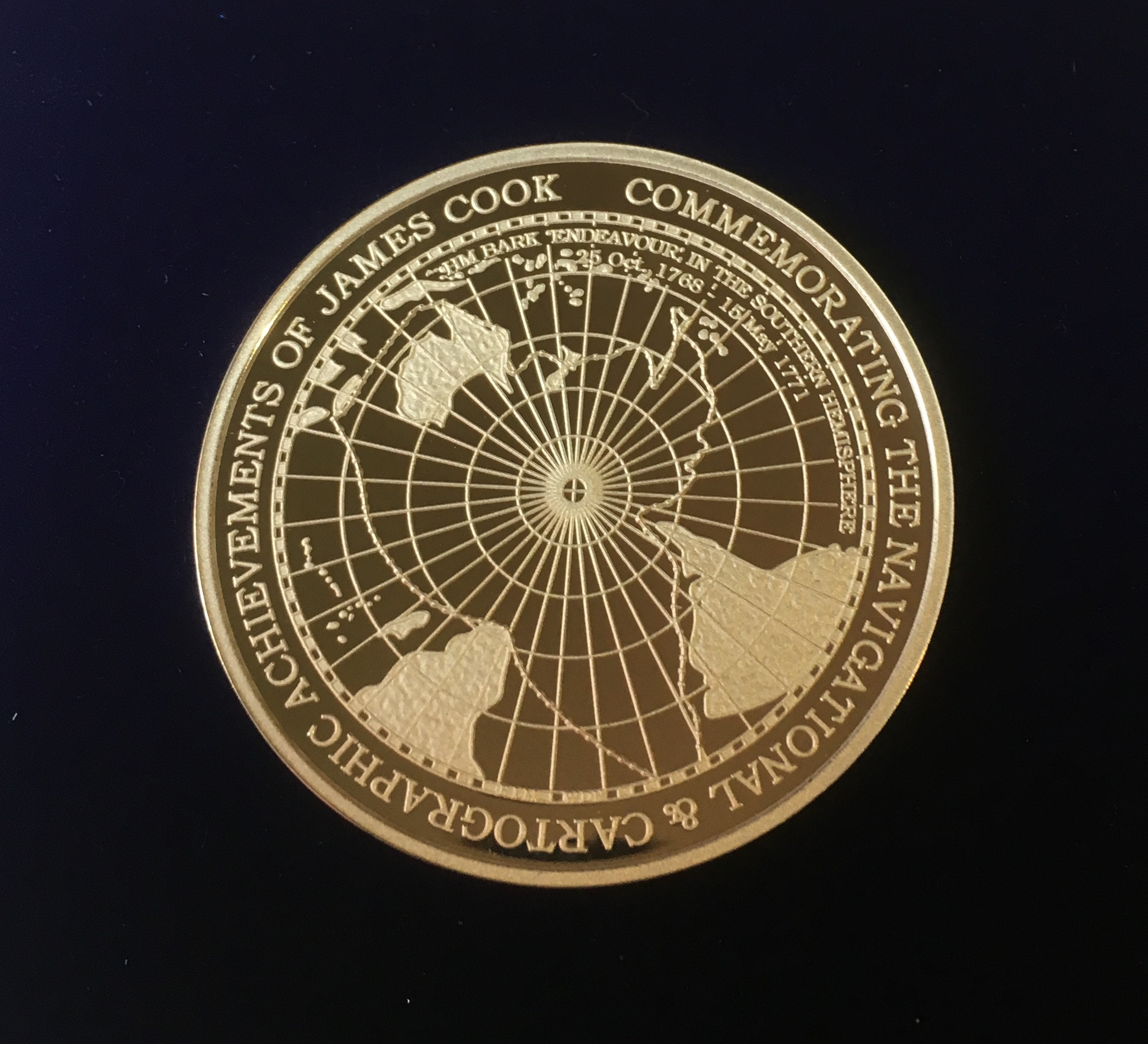 The medal reverse shows course of James Cook and the 'Endeavour' in the southern hemisphere